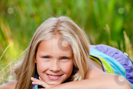 Smiling little blond girl stock photo, Happy children having fun in the park by Frenk and Danielle Kaufmann