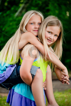 Bunny hopping twins stock photo, Happy children having fun in the park by Frenk and Danielle Kaufmann