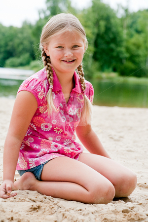 Sweet young child in the sand stock photo, Happy children having fun in the park by Frenk and Danielle Kaufmann