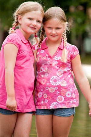Girlfriends in the sun stock photo, Happy children having fun in the park by Frenk and Danielle Kaufmann