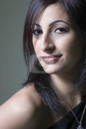 Fashion model stock photo, Fashion model looking for shoulder in little black dress by Yann Poirier