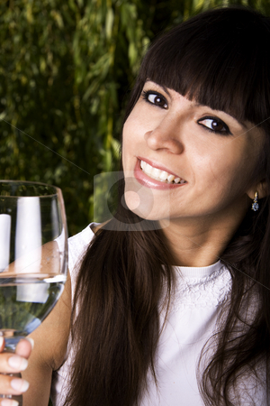 Woman drinking white wine stock photo, Beautiful stylish latina woman is drinking champagne by Daniel Kafer