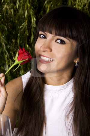 Brunette with rose stock photo, Beautiful Brazilian young woman smelling a rose by Daniel Kafer