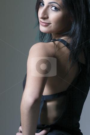Fashion model stock photo, Fashion model looking over shoulder by Yann Poirier