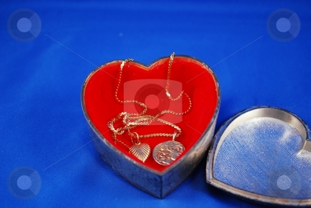 Silver and gold stock photo, Red,silver and gold hearts all in one box by Charles Bacon jr