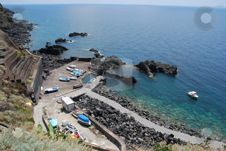 The Smallest Port Of Word: Ginostra stock photo, The image show the smallest port of the word it's located at Ginostra Stromboli. The size is one small boat. by Antonino Sicali