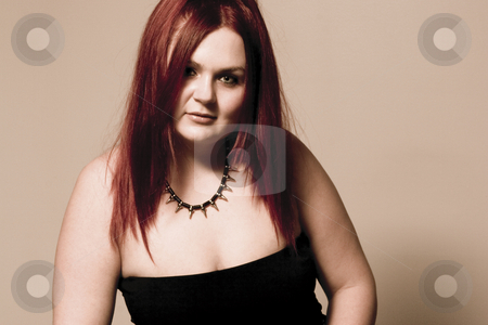 Goth rock red hair chick - sepia stock photo, Red hair female model in suggestive position and goth look by Yann Poirier