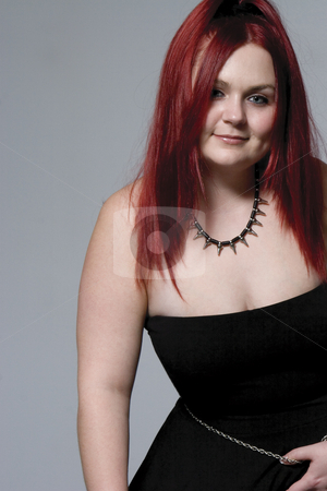 Goth rock red hair chick stock photo, Red hair female model in suggestive position and goth look by Yann Poirier