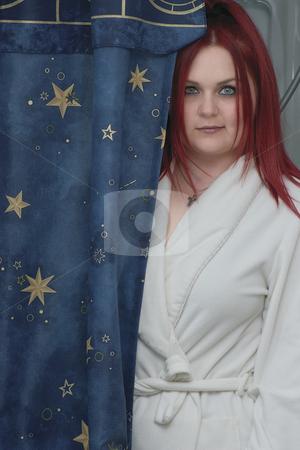 Red hair model in bathroom stock photo, Red hair woman model in white bathrobe standing in bathroom by Yann Poirier
