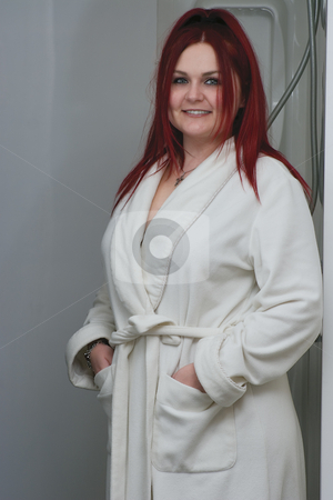 Red hair model in bathrobe stock photo, Red hair woman model in white bathrobe standing in bathroom by Yann Poirier