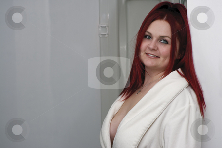 Red hair model in bathroom stock photo, Red hair woman model in white bathrobe standing in bathroom by Yann Poirier