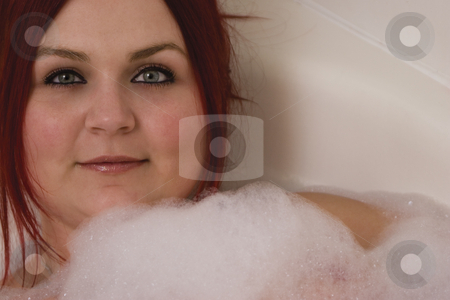 Red hair model in bath stock photo, Close up of a red hair model in bubble bath by Yann Poirier