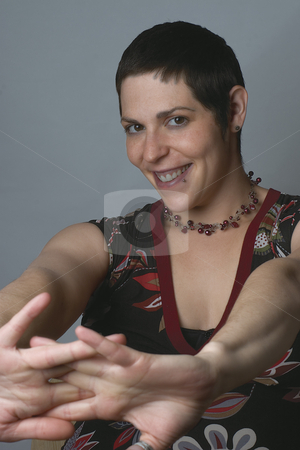 Model strenching stock photo, Female model smiling and strenching by Yann Poirier