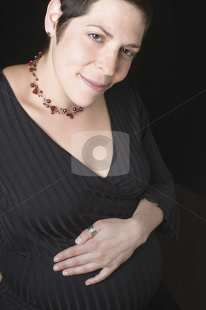 Pregnant women stock photo, Seven month pregnant women, dress in black by Yann Poirier