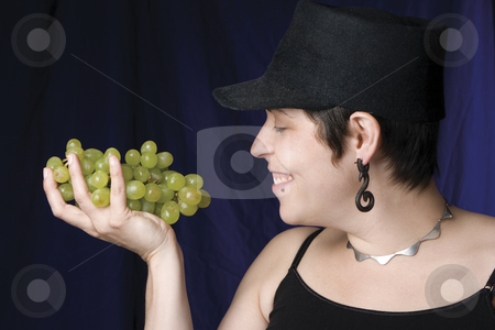 Model - grape stock photo, Thirty something model eating green grapes by Yann Poirier
