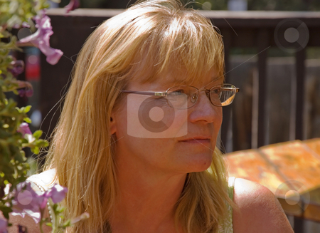 Woman Enjoying Quiet stock photo, This midlife Caucasian woman is enjoying a quiet moment outdoors in a peaceful setting. by Valerie Garner