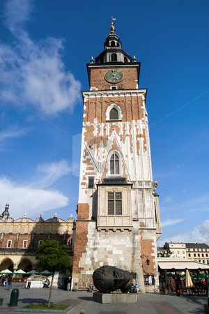 Town Hall Tower in Cracow stock photo, Town Hall gothic tower in Main Market Square in the Old Town district of Cracow, Poland. Built of stone and brick at the end of the 13th century, It's cellars once housed a city prison with a medieval torture chamber. by Rognar