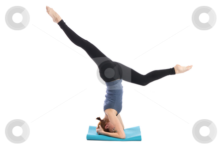 Fitness Exercise stock photo, Woman standing on the head, isolated on white background. by Rognar