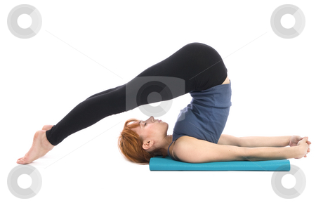 Yoga Exercise stock photo, Young woman doing yoga exercise (Halasana), isolated on white background. by Rognar