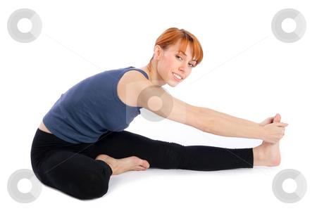Woman doing Yoga Exercise stock photo, Woman doing yoga exercise called Janu Sirsasana, isolated on white background. by Rognar