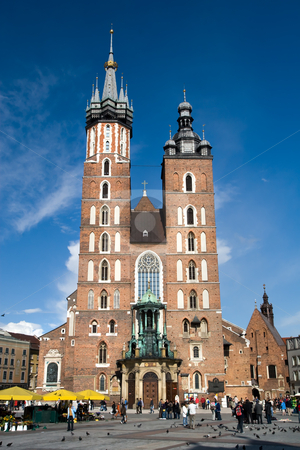 The basilica of the Virgin Mary stock photo, The basilica of the Virgin Mary, brick Gothic church re-built in the 14th century (originally built in the early 13th century), at Cracow central Grand Square, Poland. by Rognar