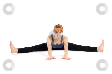 Young Woman doing Yoga Exercise stock photo, Young relaxed smiling woman doing yoga exercise called Upavistha Konasana, isolated on white background. by Rognar