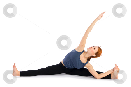 Woman doing Yoga Exercise stock photo, Young attractive woman doing yoga exercise called Upavistha Konasana , isolated on white background. by Rognar