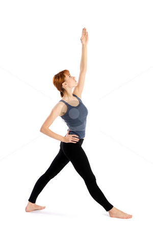 Woman in Yoga Pose stock photo, Woman in opening pose for yoga exercise called  Pavritta Trikonasana, isolated on white background. by Rognar