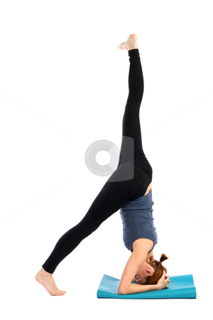 Fitness Woman stock photo, Young female doing yoga exercise, isolated on white background. by Rognar