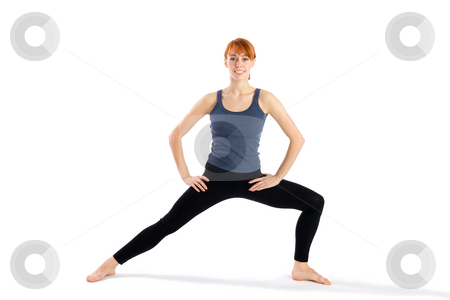 Woman in Yoga Pose stock photo, Woman in opening pose for yoga exercises called Virabhadrasana and Parsvakonasana, isolated on white background by Rognar