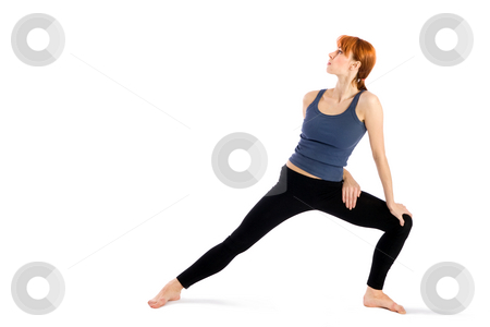 Woman doing Yoga Exercise stock photo, Woman in opening pose for yoga exercise called Trikonasana, isolated on white background. by Rognar