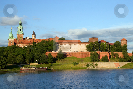 The Wawel Royal Castle and Vistula River stock photo, The Wawel Royal Castle in Cracow, Poland built in 14th at the behest of Casimir III the Great, rebuilt by Jogaila and Jadwiga of Poland. Vistula river on the first plan. by Rognar