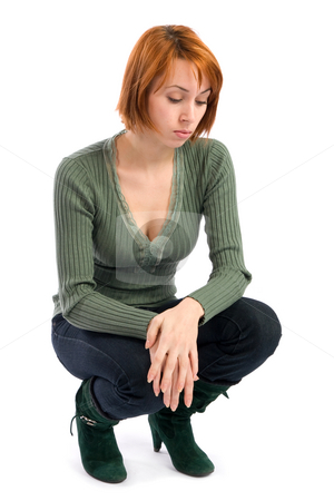 Sad Woman in Contemplative Mood stock photo, Sad young woman in contemplative mood crouching, isolated over white background. by Rognar