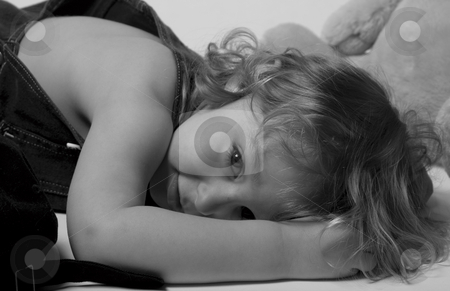 Sleeping kid stock photo, Two year old boy taking a nap among his toy by Yann Poirier