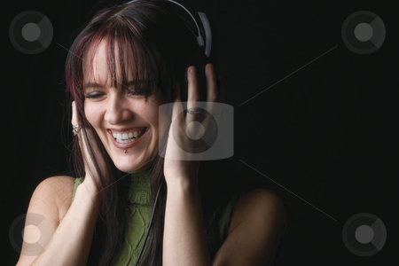 Fashion model - music stock photo, Twenty something fashion model listening to music and laughing by Yann Poirier