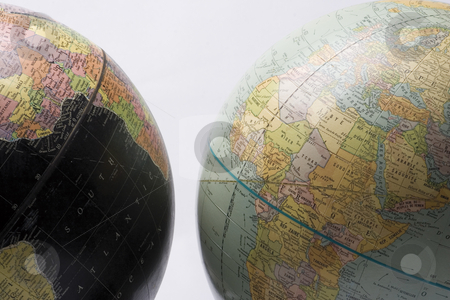 Dark and light globe stock photo, A dark globe showing africa facing a light globe also showing africa by Yann Poirier