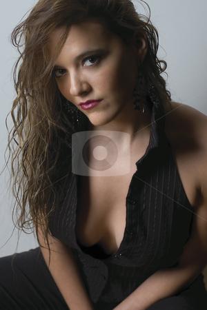 Fashion model - sexy business suit stock photo, Late twentie female model in open business suit by Yann Poirier
