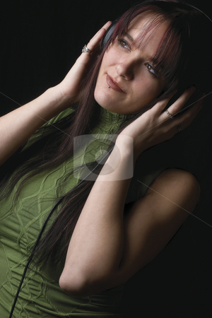 Fashion model - music stock photo, Twenty something fashion model listening to music by Yann Poirier