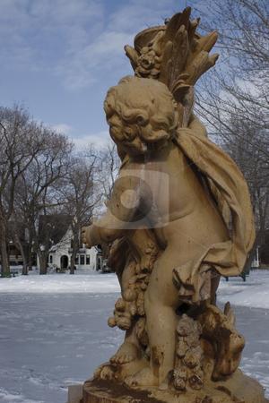 Cherubin statue stock photo, Cherubin statue during winter in a park by Yann Poirier
