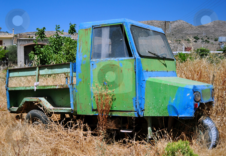 Old farm vehicle stock photo, Abandoned vehicle in rural area, island of Crete. by Fernando Barozza