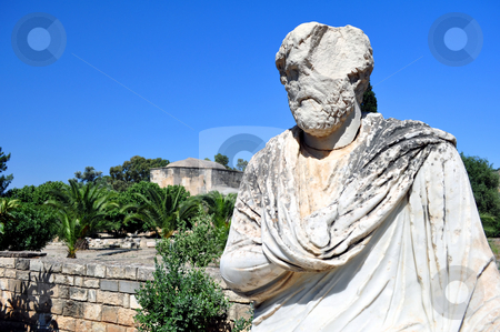Greek statue stock photo, Travel photography: marble roman statue and the Ayios Titos Basilica at Gortyn by Fernando Barozza