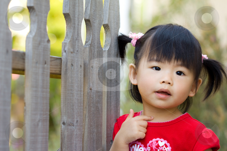 Cute little Asian Chinese girl stock photo, Close up of Asian chinese child stands beside fence by Hieng Ling Tie