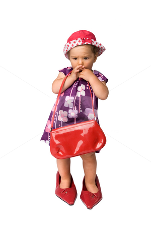 Baby Girl and Big Shoes stock photo, Funny fashion shoot with cute one year old girl wearing a big oversized shoes, isolated on white background. by Rognar