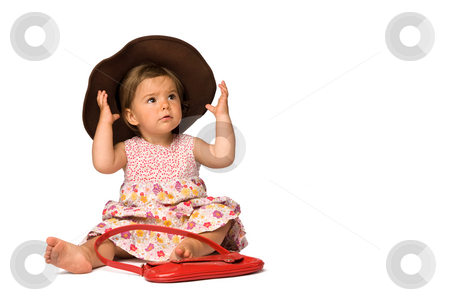 Baby Girl Fashion stock photo, One year old girl fashion model posing with purse and hat, isolated over white background. by Rognar