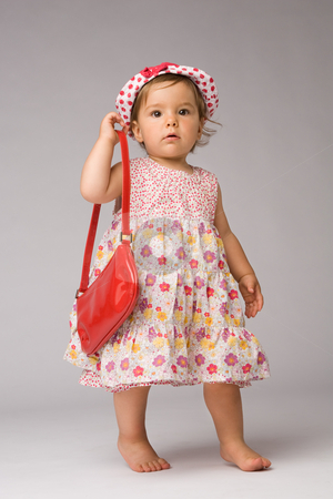 Fashion Baby Posing stock photo, One year old girl fashion model posing with purse and hat. by Rognar
