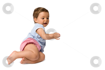 Baby Girl Trying to Touch Something stock photo, Pretty baby girl sitting on the ground trying to touch something, isolated on white background. by Rognar