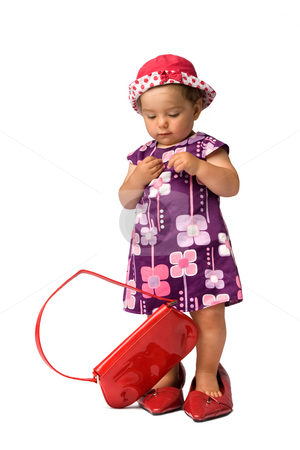 Fashion Baby Girl Posing stock photo, Young baby girl funny fashion shoot with an adults purse an shoes, isolated on white background. by Rognar