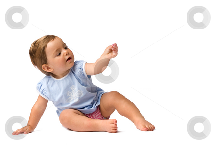 Baby Girl in Hold Something Pose stock photo, Pretty baby girl sitting on the ground in hold something pose, isolated on white background. by Rognar