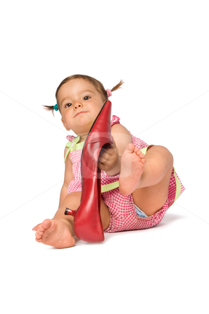 Baby Girl Try On Shoe stock photo, One year old baby girl try on big red shoe, isolated on white background. by Rognar