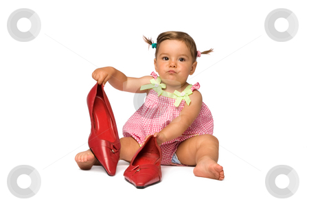 Baby Girl with Red Pumps stock photo, One year old baby girl playing with red pumps, isolated on white. by Rognar